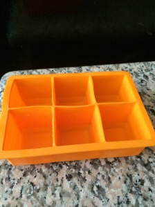 I use different sized silicone ones like this. P.S. They make perfect squares for the cutest ice cubes for cocktails after this baby food phase is over and done!